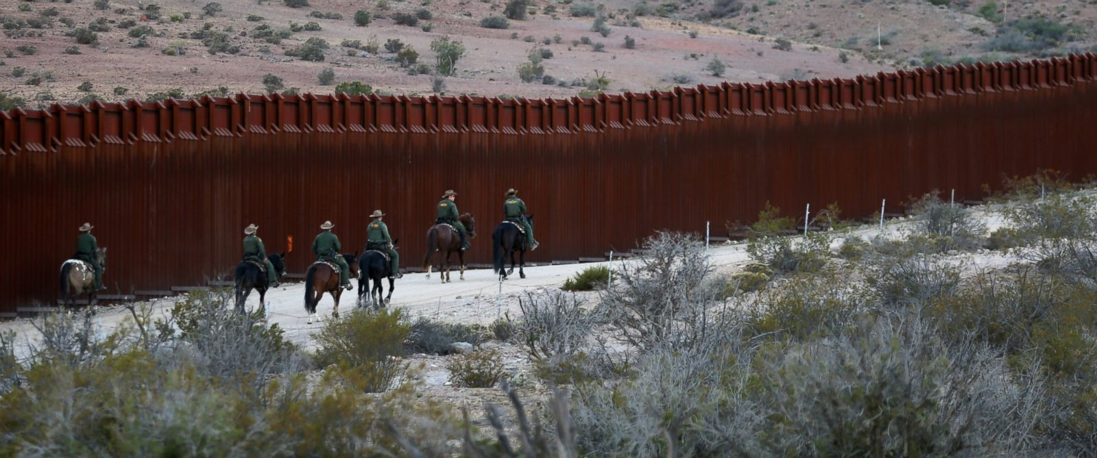 PHOTO: U.S. Border Patrol agents on horseback head out on patrol along the U.S.-Mexico border fence near Jacumba, California, Nov. 14, 2016.