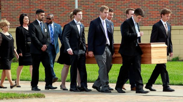 PHOTO: Otto Warmbier's casket is carried to the hearse followed by his family and friends after a funeral service for Warmbier, who died after his release from North Korea detention in a coma, at Wyoming High School in Wyoming, Ohio, June 22, 2017.