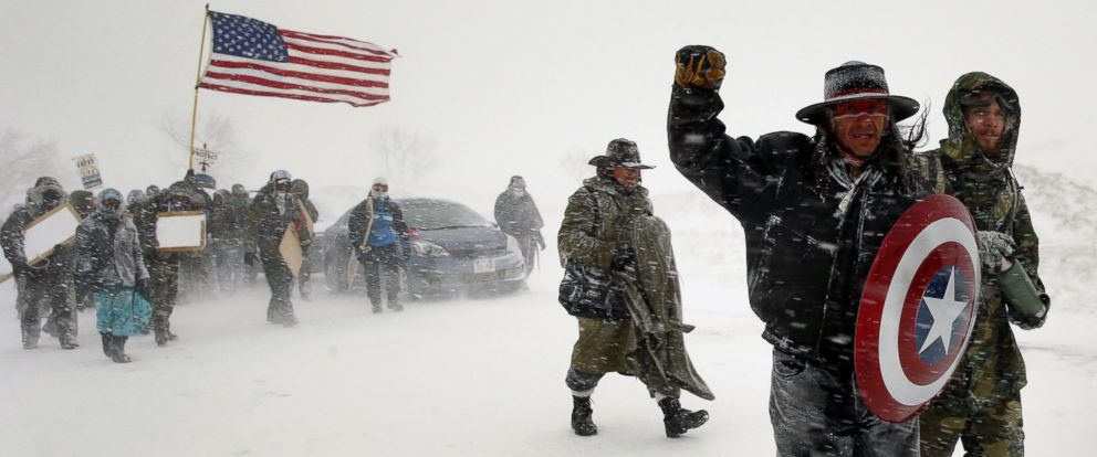 "PHOTO: Veterans join activists in a march to Backwater Bridge just outside the Oceti Sakowin camp during a snow fall as ""water protectors"" continue to demonstrate against plans to pass the Dakota Access pipeline, Cannon Ball, North Dakota, Dec. 5, 2016."