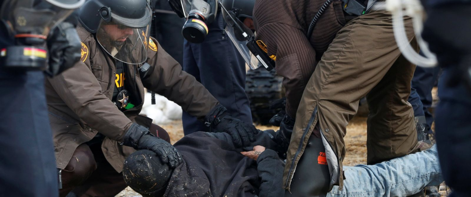 PHOTO: Police detain a protester in the main opposition camp against the Dakota Access oil pipeline near Cannon Ball, North Dakota, Feb. 23, 2017.