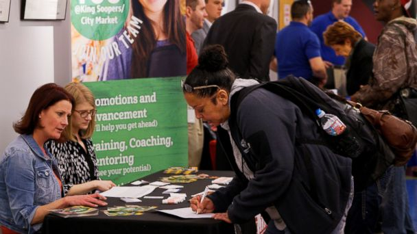 PHOTO: A job seeker fills out an application at a job fair at the Denver Workforce Center in Denver, Colorado, Feb. 15, 2017.