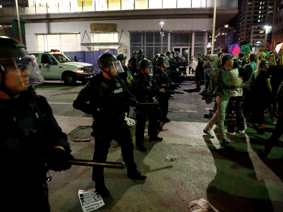 PHOTO: Demonstrators are blocked by an LAPD skirmish line during a march through the streets of downtown Los Angeles in protest in Los Angeles, Nov. 11, 2016.