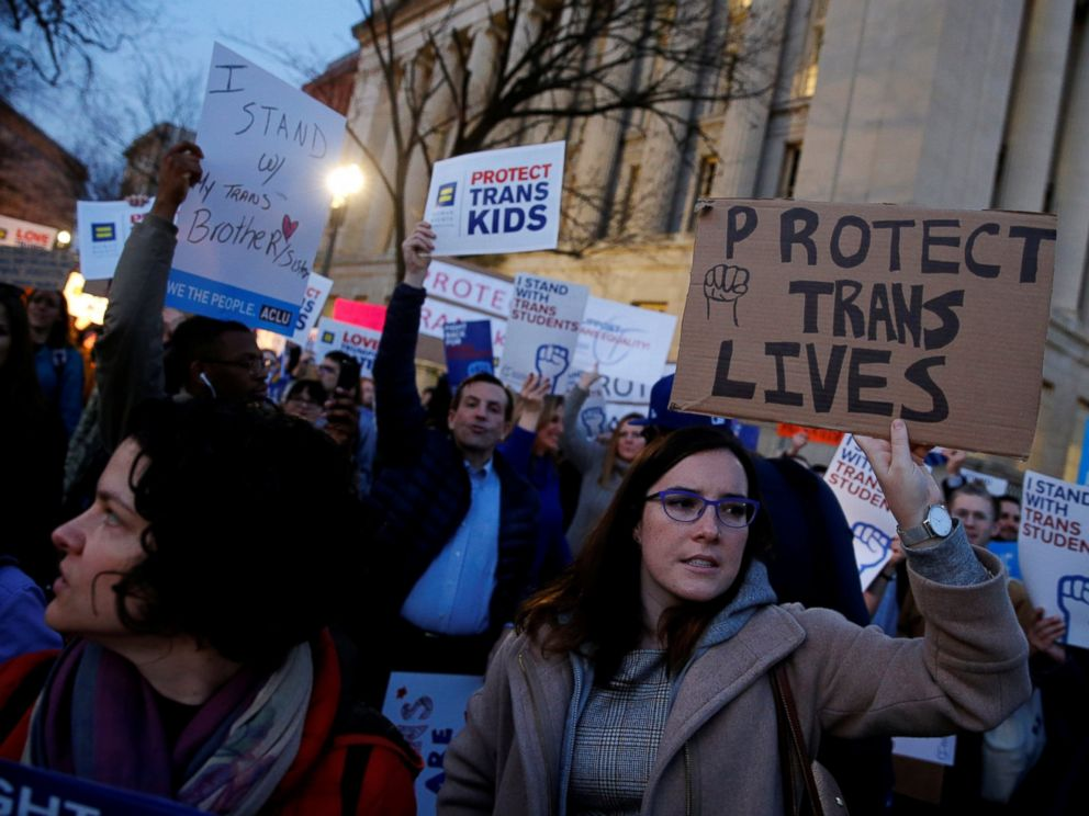 PHOTO: Transgender activists and supporters protest potential changes by the Trump administration in federal guidelines issued to public schools in defense of transgender student rights, near the White House in Washington, Feb. 22, 2017.