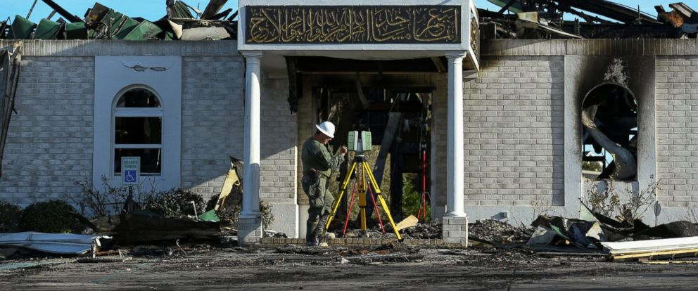 PHOTO: A security official investigates the aftermath of a fire at the Victoria Islamic Center mosque in Victoria, Texas January 29, 2017.