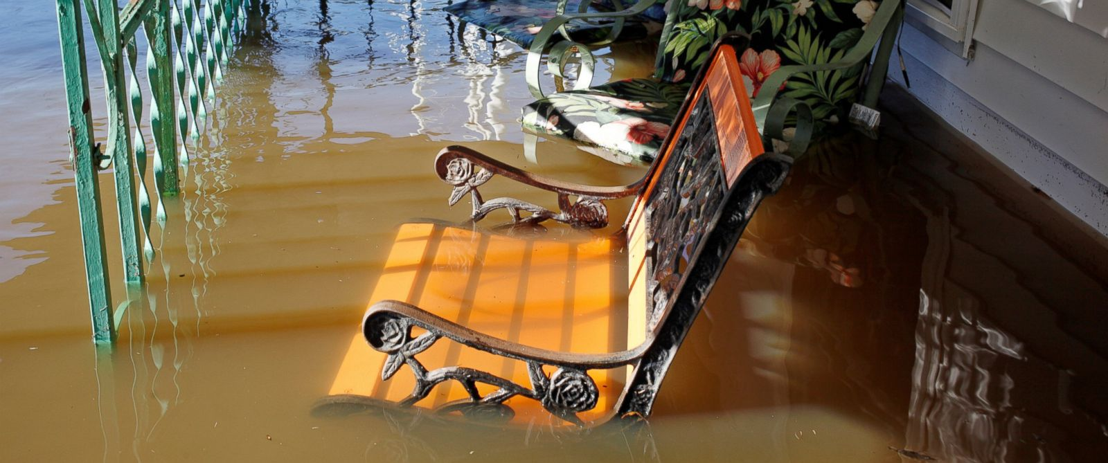 PHOTO: Flood waters from the swollen Tar River rise into a residential porch in the aftermath of Hurricane Matthew, in Tarboro, North Carolina, on Oct. 13, 2016.
