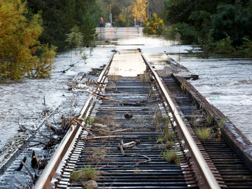 PHOTO: Debris swept downriver by the rising Tar River litter a flooded rail bridge crossing the river from Tarboro into Princeville as the river crests in the aftermath of Hurricane Matthew, in Tarboro, North Carolina, on Oct. 13, 2016.