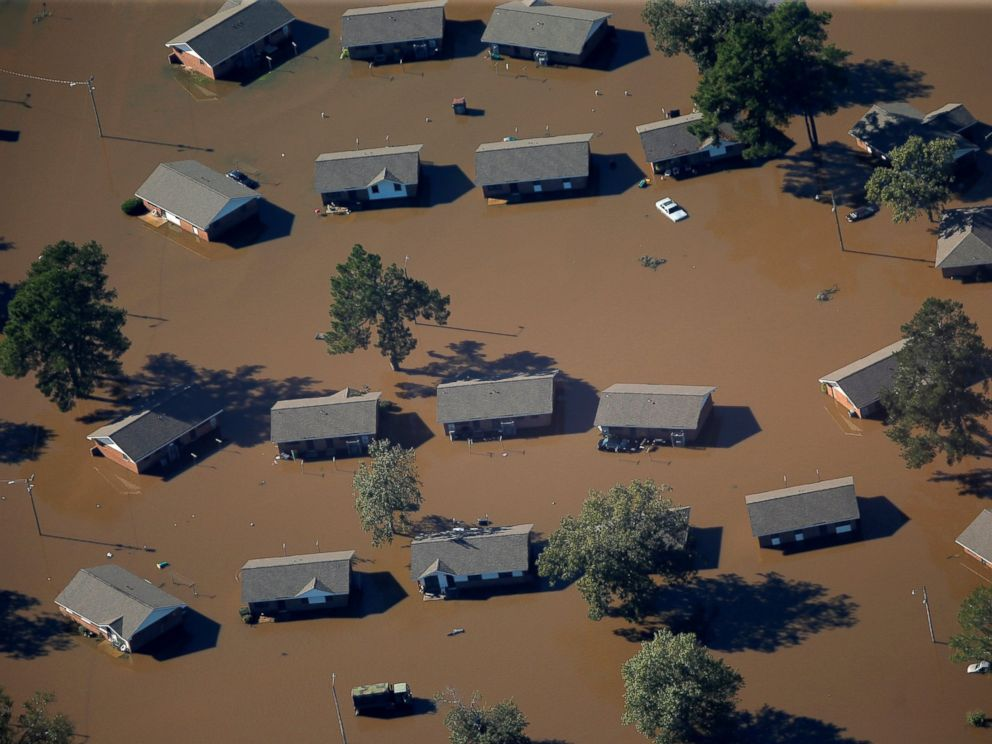 PHOTO: An aerial view of a neighborhood that was flooded after Hurricane Matthew, on Oct. 10, 2016, in Lumberton, North Carolina.