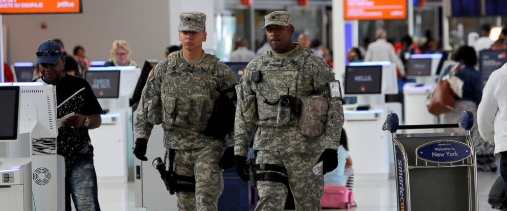 PHOTO: Members of the U.S. Army monitor the departures area at John F. Kennedy international Airport in New York, June 29, 2016.