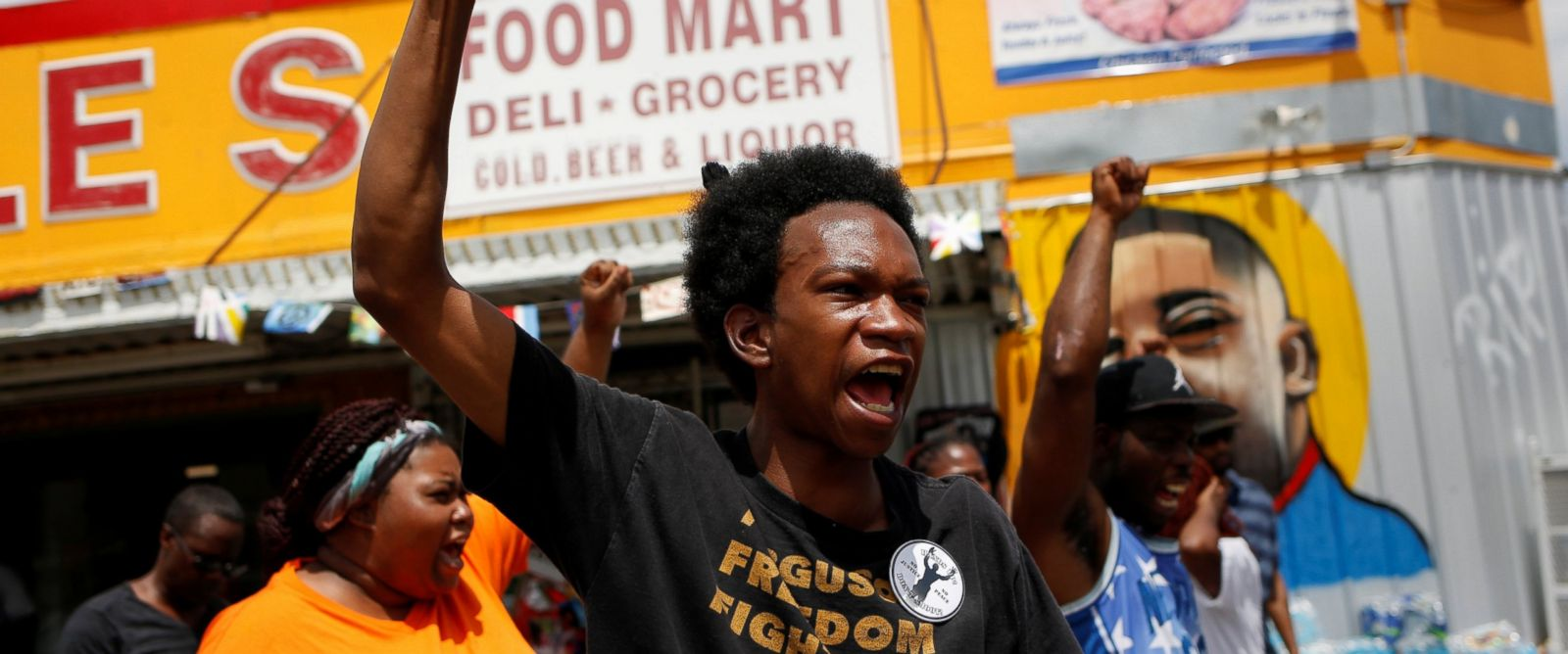 PHOTO: Demonstrators gather outside the Triple S convenience store on July 10, 2016, in Baton Rouge, Louisiana, where Alton Sterling was shot dead by police.