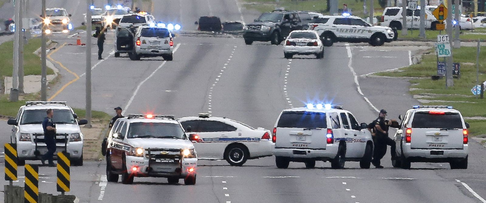 PHOTO: Law enforcement vehicles block access to Airline Highway near the scene of a fatal shooting of police officers in Baton Rouge, Louisiana, July 17, 2016.