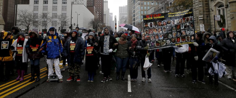 PHOTO: Demonstrators link arms during a protest intending to disrupt Black Friday shopping in reaction to the fatal shooting of Laquan McDonald in Chicago, Nov. 27, 2015.