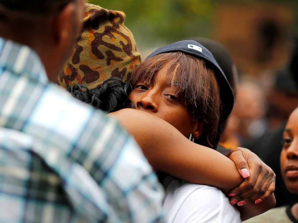 PHOTO: Diamond Reynolds, girlfriend of Philando Castile, gets a hug as people gather to protest the fatal shooting by Minneapolis area police during a traffic stop, July 7, 2016, in St. Paul, Minnesota.