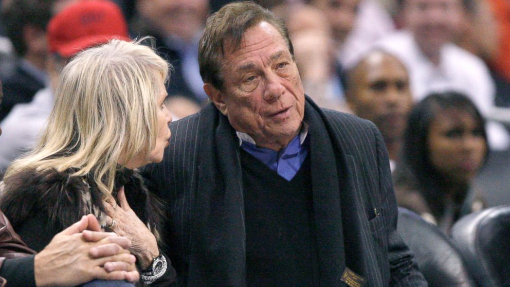 PHOTO: Los Angeles Clippers owner Donald Sterling sits with a companion as he watches the team play New York Knicks in Los Angeles, Feb. 11, 20