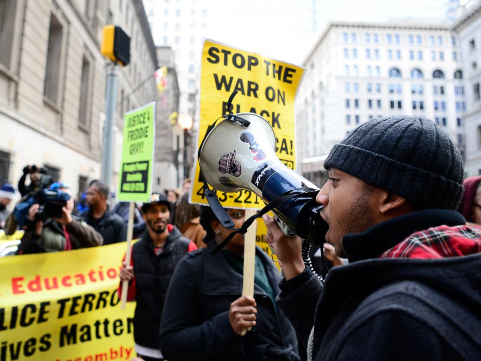 PHOTO: Darius Rosebauth speaks into a megaphone as a demonstration begins after a Maryland judge declared a mistrial in the trial of Baltimore polce officer William Porter in Baltimore, Dec. 16, 2015.