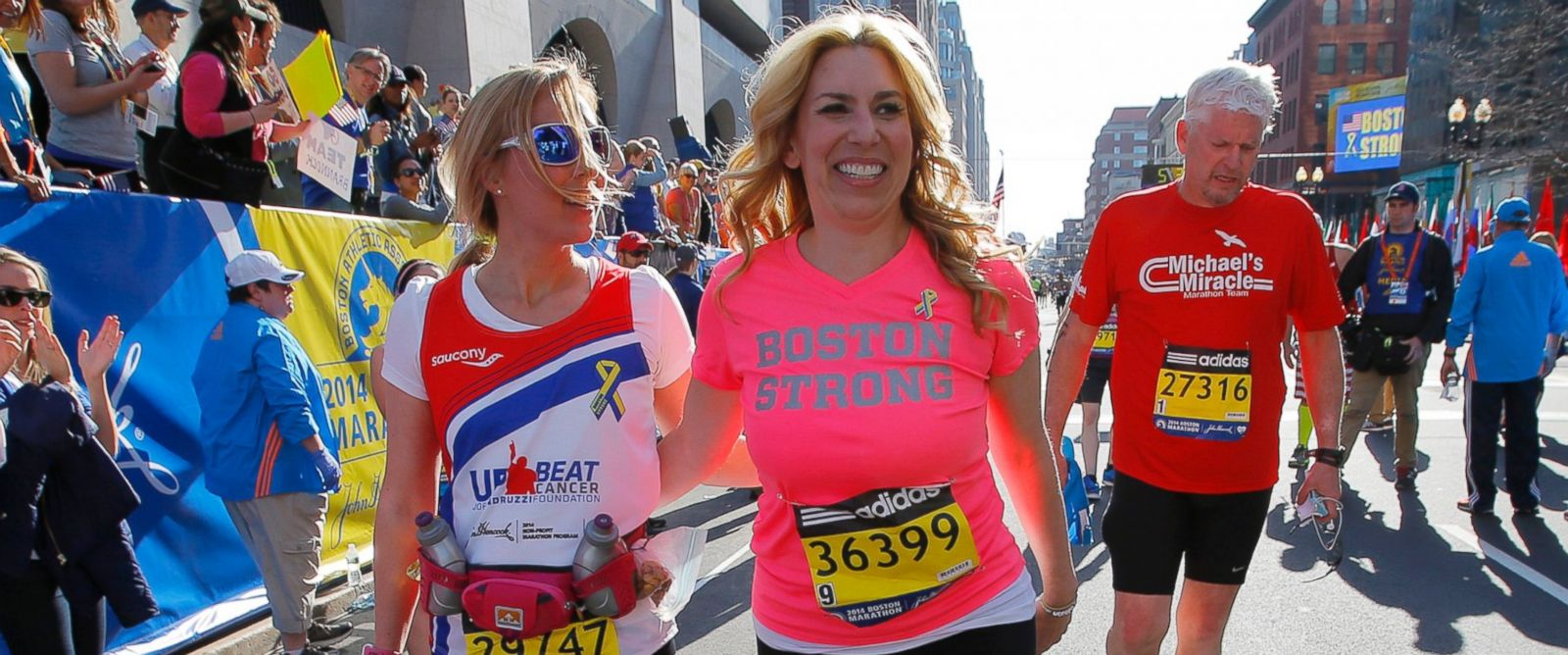 PHOTO: 2013 Boston Marathon survivor Heather Abbott, right, finishes the 118th Boston Marathon with Erin Chatham, one of the people who helped rescue Abbott and who ran the race this year in Boston, April 21, 2014.