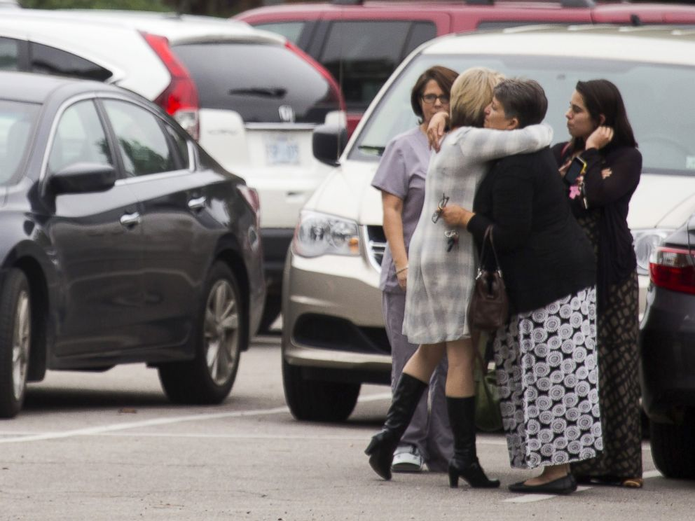 PHOTO: Mourners embrace before funeral services for six-year-old Jeremy Mardis at Moore Funeral Chapel in Hattiesburg, Mississippi, Nov. 9, 2015.