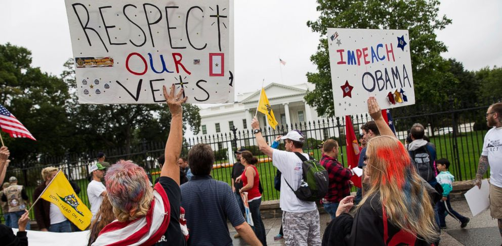 "PHOTO: Protesters with the ""Million Vet March on the Memorials"" call for impeachment of President Barack Obama in front of the White House in Washington, Oct. 13, 2013."