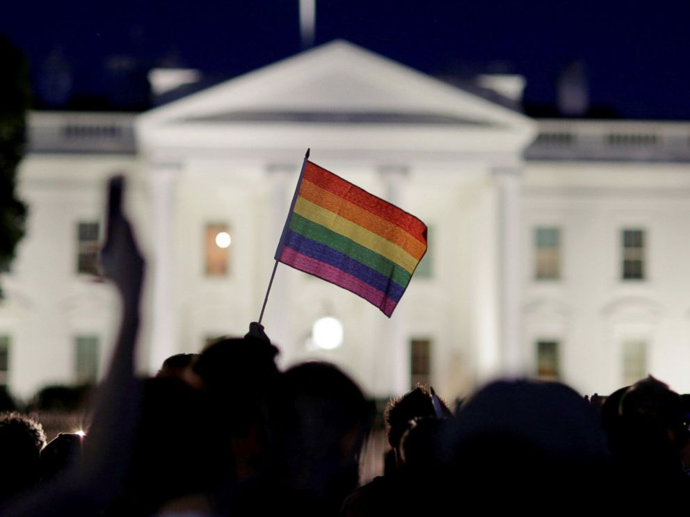 PHOTO: A rainbow flag is held up during a vigil after the worst mass shooting in U.S. history at a gay nightclub in Orlando, in front of the White House in Washington, June 12, 2016.