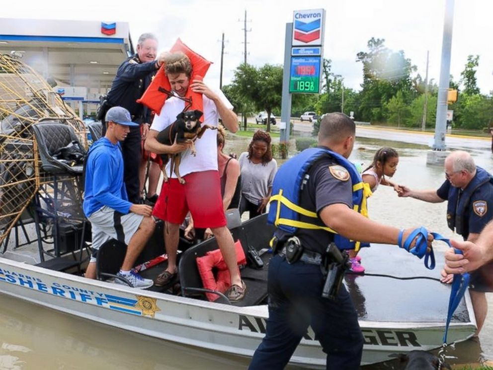 PHOTO: Harris County Sheriff deputies help residents evacuate from high water in the Wimbledon Champions subdivision of Houston, Texas, April 20, 2016.