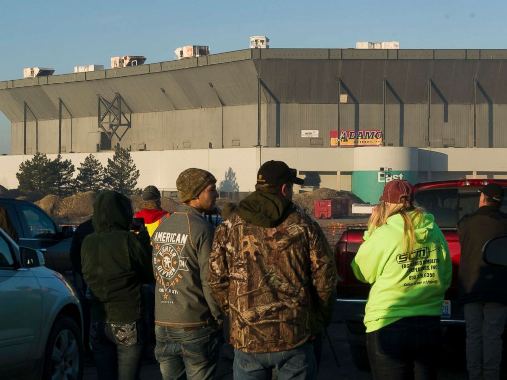 PHOTO: People stand and stare after an attempt a a partial collapse of the Silverdome, in Pontiac, Mich., Dec. 3, 2017. Technical problems with the explosives left the stadium still standing after the blast.