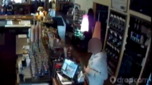 VIDEO: Surveillance video shows the suspect leave an Ohio coffee bar with more than coffee.