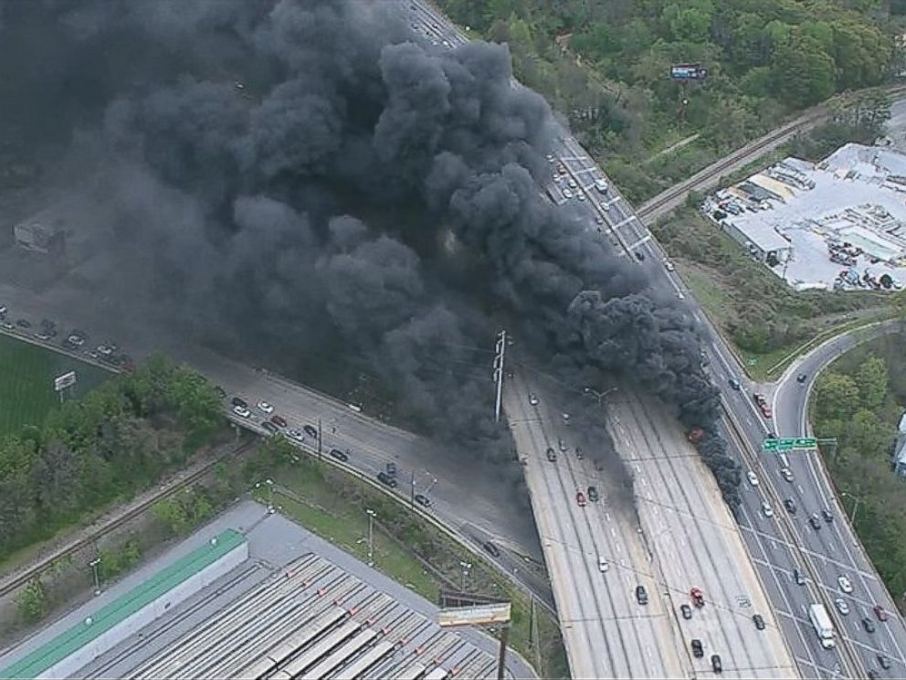 PHOTO: A massive fire burns underneath an overpass of Interstate 85 in Midtown as seen from an aerial view.