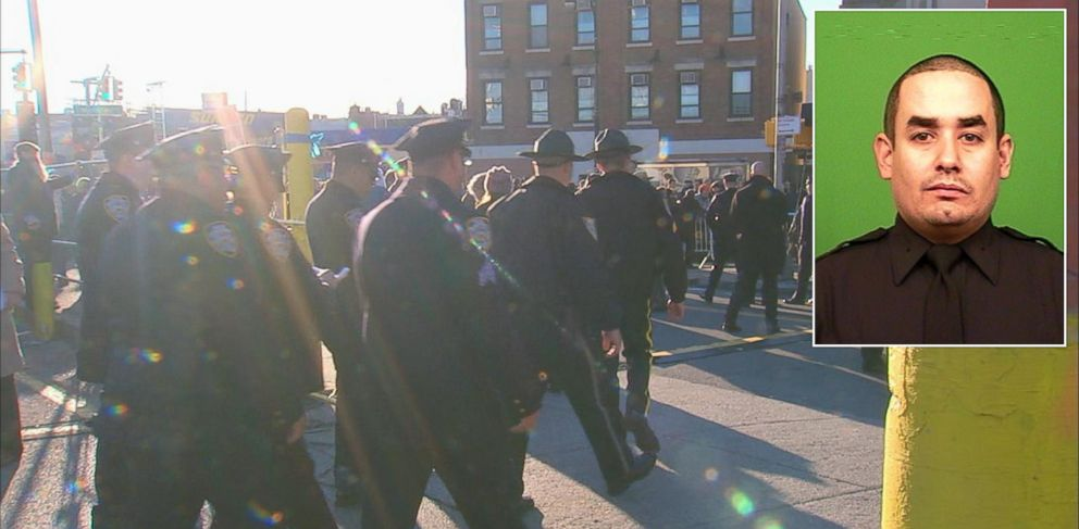 PHOTO: Police officers assemble before the funeral of Rafael Ramos at Christ Tabernacle Church in the Glendale section of Queens, where he was a church member, Dec. 27, 2014, in New York.
