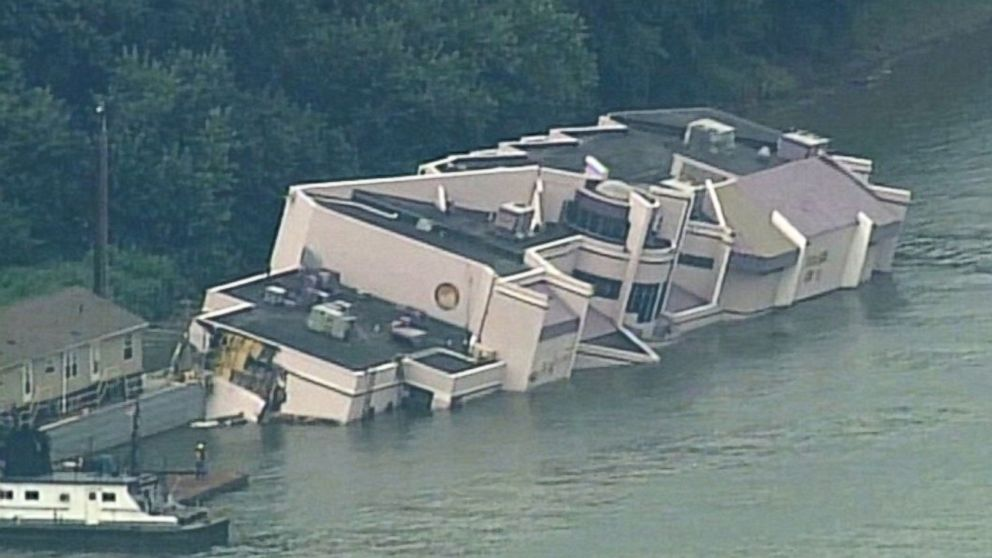 PHOTO: Aerial footage shows Jeff Rubys Waterfront restaurant sinking into the Ohio River while undergoing repairs in Hebron, Kentucky on August 5, 2014.