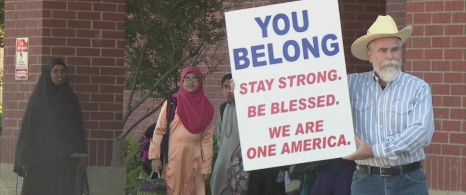 """PHOTO: Justin Normand held a sign that read, """"You belong: Stay strong. Be blessed. We are one America"""" outside the Islamic Center of Irving in Texas in a show of solidarity with the Muslim community."""