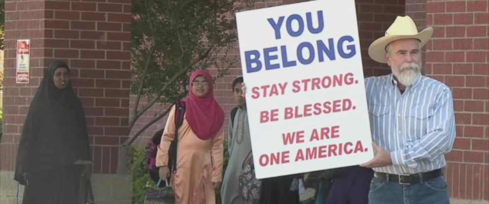 "PHOTO: Justin Normand held a sign that read, ""You belong: Stay strong. Be blessed. We are one America"" outside the Islamic Center of Irving in Texas in a show of solidarity with the Muslim community."