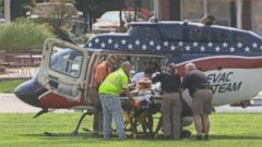 PHOTO: A man is loaded onto a medical helicopter on August 21, 2014 after several firefighters were shocked after assisting with an ice bucket challenge in Campbellsville, Kentucky on August 21, 2014.