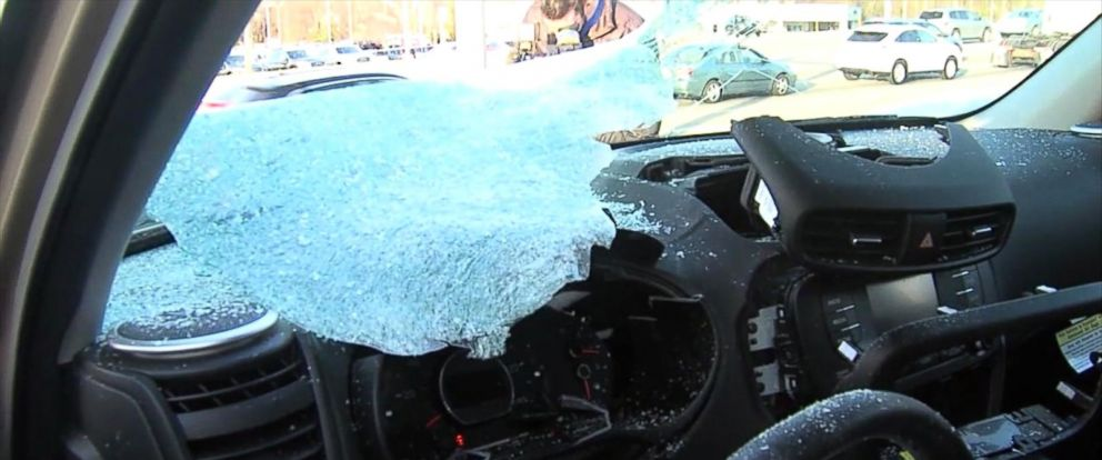 PHOTO: A chunk of ice fell onto the windshield of a brand new car at a dealership in Mechanicsburg, Pa., March 25, 2016.