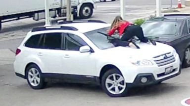 Wisconsin woman leaps on her car to stop carjacker