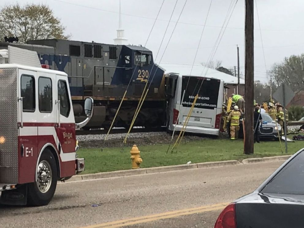 At least four dead after train collides with charter bus