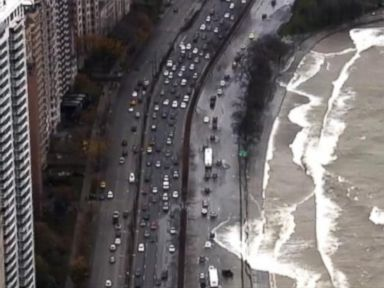 PHOTO: Waves from Lake Michigan crash over Chicagos Lake Shore Drive, Oct. 31, 2014.