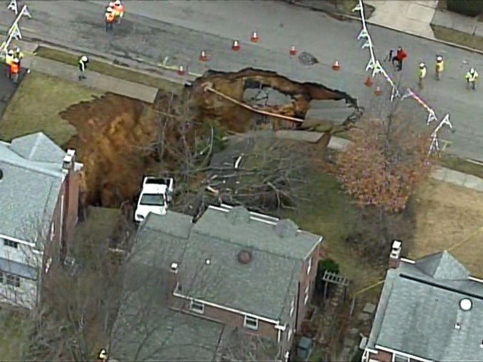 PHOTO: A large sinkhole opened up in Cheltenham Township, Pennsylvania, early in the morning on Wednesday, Jan. 25, 2017.