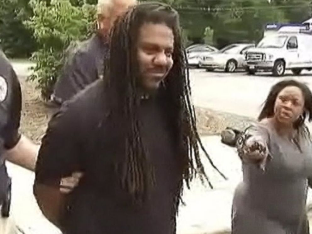 PHOTO: N.C. resident Sharman Odom, 34, was seen smirking while being escorted following his arrest, Aug. 2, 2014, in connection with the murder of Maggie Daniels.