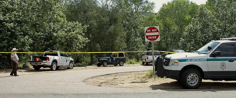 The Water Wheel Campground parking lot is blocked off by authorities Sunday, July 16, 2017, in the Tonto National Forest, Ariz., after a deadly flash-flooding hit Saturday afternoon at Cold Springs canyon. The flooding came after a severe thunderstor