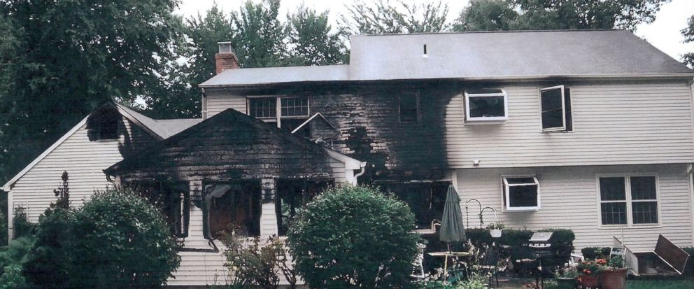 FILE - This July 2007 file photo provided by police, made available Sept. 21, 2011, by the Connecticut Judicial Branch as evidence and presented in the Joshua Komisarjevsky trial in New Haven, Conn., shows a fire-damaged portion of the William Petit