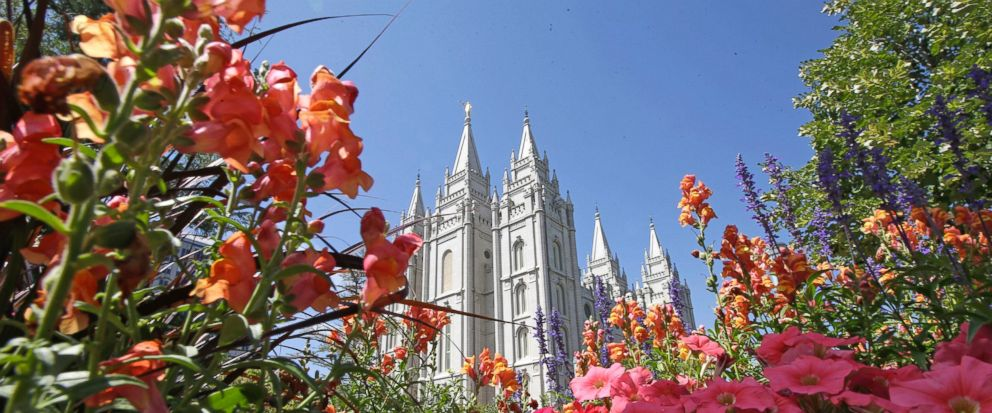 FILE - This Aug. 4, 2015, file photo, flowers bloom in front of the Salt Lake Temple, at Temple Square, in Salt Lake City. Mormon church leader James J. Hamula was removed Tuesday, Aug. 8, 2017, from a mid-level leadership council for undisclosed rea