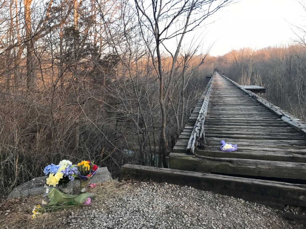PHOTO: Flowers sit by a bridge near Delphi, Ind. where Liberty German and Abigail Williams were seen before they were reported missing by their families on Feb. 13, 2017.