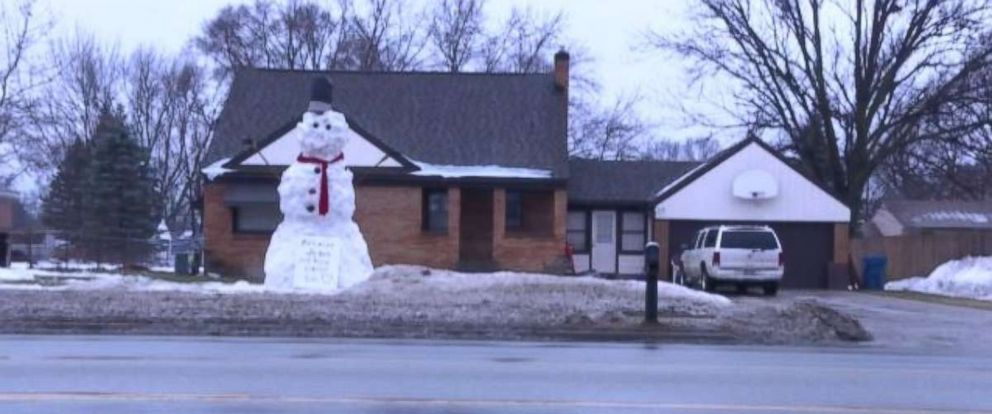 A family in Georgetown Township, Michigan, constructed an 18-foot snowman in their yard on Jan. 11, 2018.