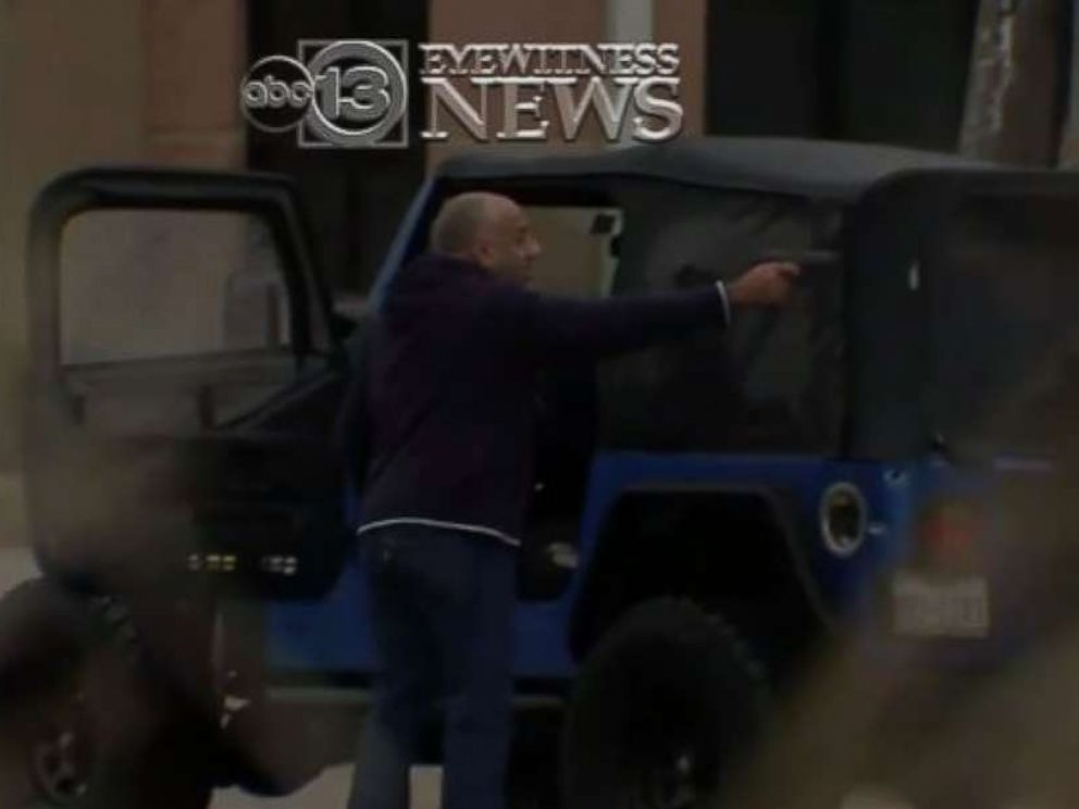 A man points a gun at another driver in a road rage incident in Houston on Dec. 6, 2017.
