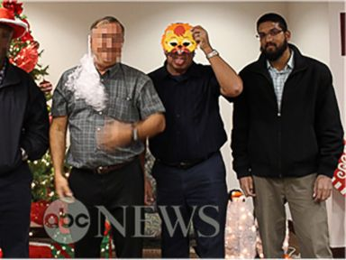 PHOTO: In a photo obtained by ABC News, Syed Farook is seen posing with his coworkers in front of a Christmas tree inside the Inland Regional Center shortly before launching into a rampage that left 14 people dead on December 2, 2015.