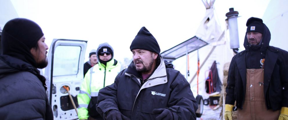 PHOTO: Henry Red Cloud, center, explains how to install a solar furnace to a protester, Dec. 21, 2016, at the Oceti Sakowin Camp on the Standing Rock Reservation in Cannon Ball, North Dakota.