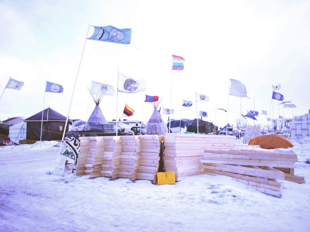 PHOTO: Lumber is piled up at the Oceti Sakowin Camp on the Standing Rock Reservation. Pipeline protesters continue to build new structures throughout the camp in Cannon Ball, North Dakota, Dec. 21, 2016.
