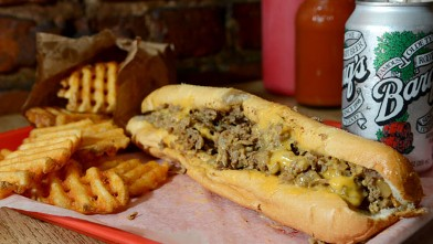 PHOTO: 99 Miles to Philly serves a classic Philly Cheesesteak with Cheese Wiz, and Amoroso Bread, with a side of Waffle fries and rootbeer, New York, Oct. 4, 2012.