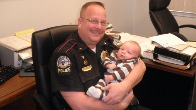 PHOTO: Police Chief Mike Maloney seen smiling with his grandson. Maloney, who was only eight days from retirement, was shot and killed during a drug raid.