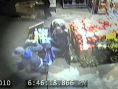 VIDEO: Surveillance footage shows a man stealing money from Girl Scout Beverly Reed.