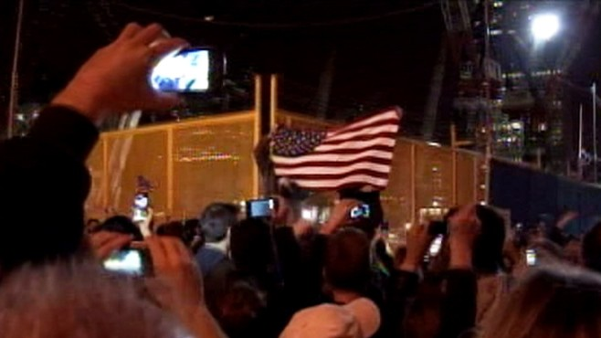 VIDEO: People gather in downtown New York City, waving flags and chanting USA.